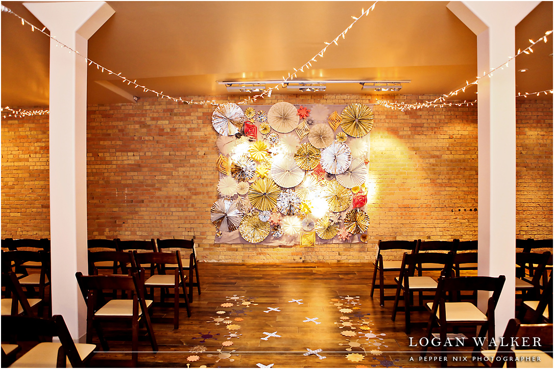 pinwheel ceremony backdrop pepper nix photography utah wedding flowers calie rose bright sparkly new years eve wedding