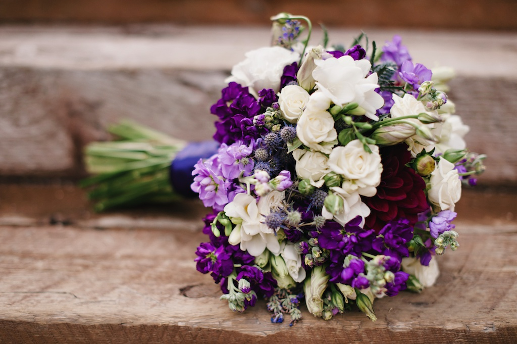 purple white wildflower inspired wedding flower bouquet utah florist calie rose mikki platt photography