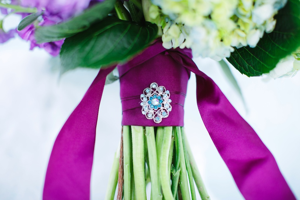 Disney's Frozen Inspired Wedding Shoot midway ice castles calie rose wedding flowers utah florist meredith carlson photography winter wedding flowers winter wedding bouquet blue brooch blue wedding brooch