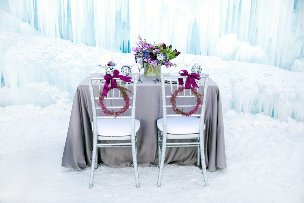 Disney's Frozen Inspired Wedding Shoot midway ice castles calie rose wedding flowers utah florist meredith carlson photography winter wedding flowers winter wedding centerpiece purple blue centerpiece winter tablescape ice inspired weddingheather wreath simple purple flower wreath chair wreaths