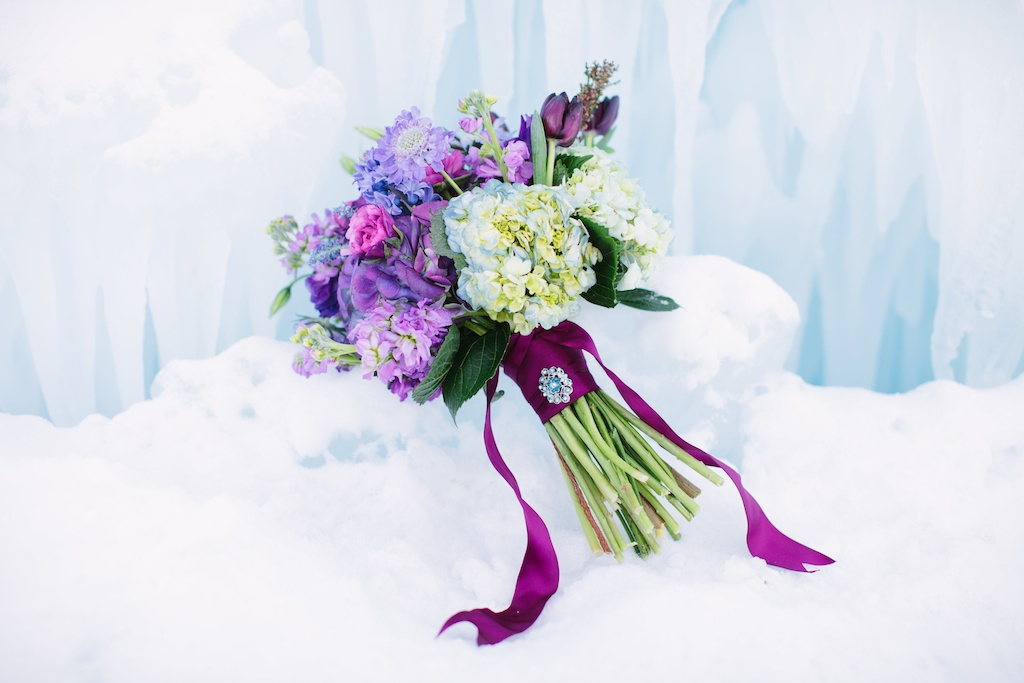 Disney's Frozen Inspired Wedding Shoot midway ice castles calie rose wedding flowers utah florist meredith carlson photography winter wedding ice inspired wedding ice wedding winter wedding flowers winter wedding bouquet purple blue wedding flower bouquet