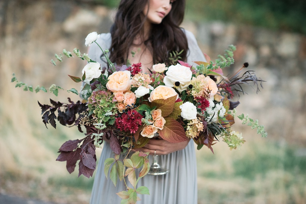 european style wedding flowers inspiration utah calie rose dusty blue wedding dress silver urn centerpiece lush garden fall urn centerpiece